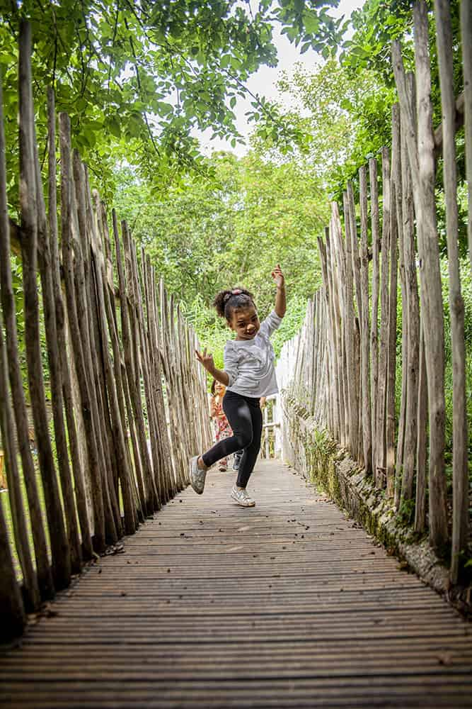 A girl dancing on the wooden bridge
