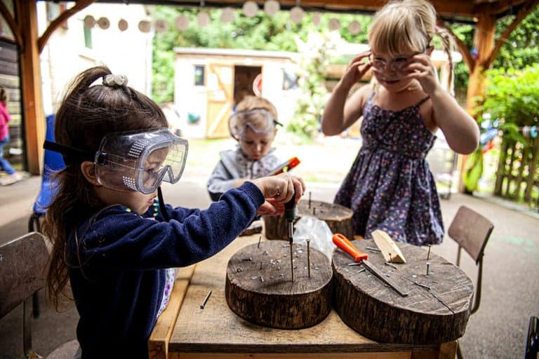 Three children using tools