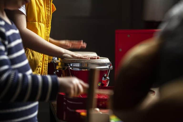 Two children playing percussion